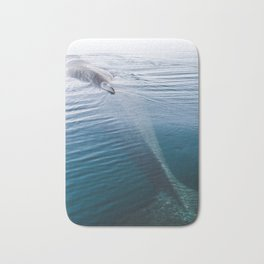 Whale bathing in the Sun of East Greenland Bath Mat