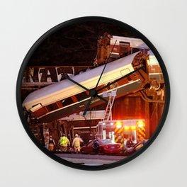 Passenger train derails Wall Clock