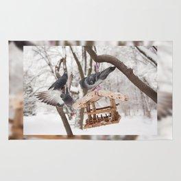 pigeons sitting on bird feeder Rug