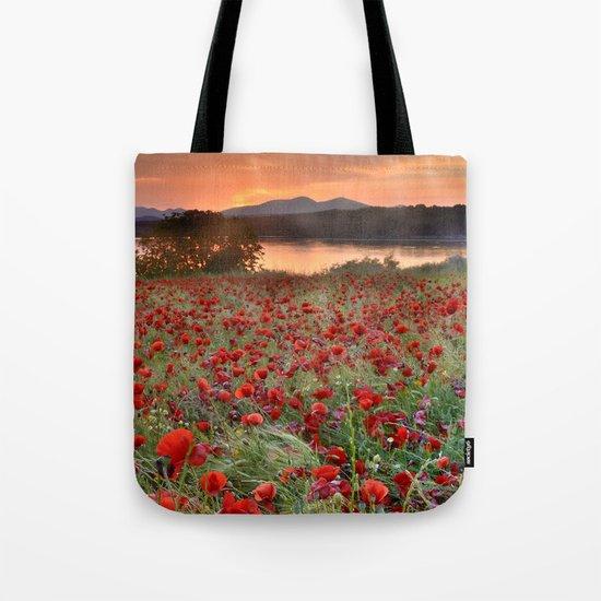 Poppies at the lake at sunset Tote Bag