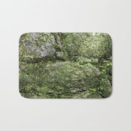 Wall of rocks covered with moss and plants Bath Mat