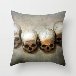 Four skulls Throw Pillow