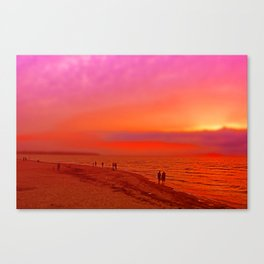 Sunset in orange and pink by the beach Canvas Print