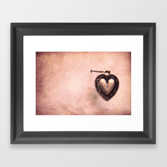 Hanging on a nail Framed Art Print
