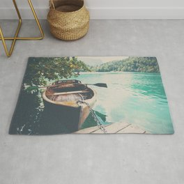 A row boat on Lake Bled, Slovenia Rug