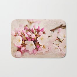 cherry blossoms with typography Bath Mat