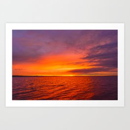 Sun flare in the cloudy sky at sunset Art Print