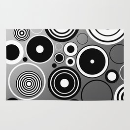 Geometric black and white rings on metallic silver Rug