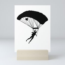 Black silhouette of a girl with ponytail doing parachute jumping exercises Mini Art Print