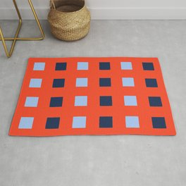 Geometric abstraction: dark and light cobalt blue squares on scarlet red Rug