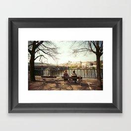 Two Women Sitting on a Bench in Prague Framed Art Print