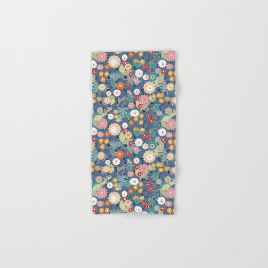 Colorful flowers on a denim background. Hand & Bath Towel