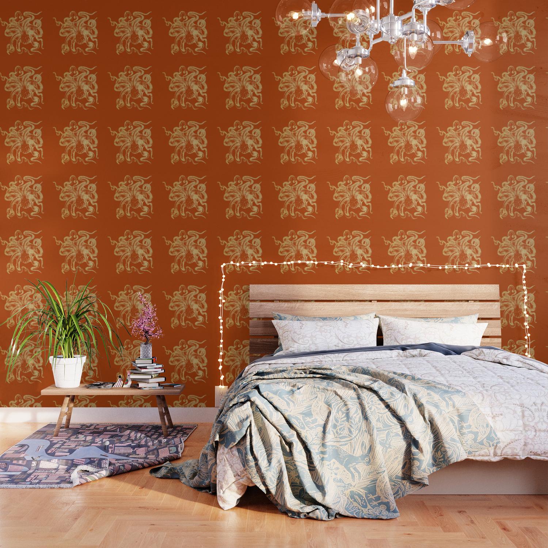 Gold octopus on burnt orange background Wallpaper