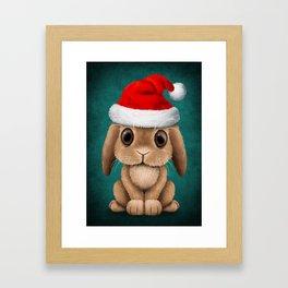 Cute Floppy Eared Baby Bunny Wearing a Santa Hat Blue Framed Art Print