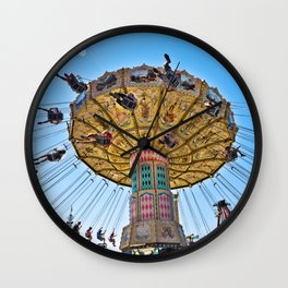 swings ride at the county fair summer fun kids blue sky spin spinning dizzy Wall Clock