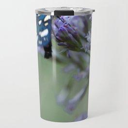 A black butterfly on a wildflower Travel Mug
