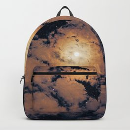 Full moon through purple clouds Backpack