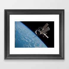 The International Space Station and the Docked Space Shuttle Endeavour Framed Art Print