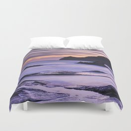 Vela blanca tower. Purple beach Duvet Cover