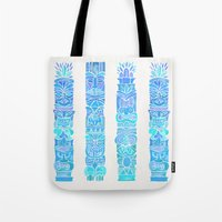 tiki Tote Bags featuring Tiki Totems – Turquoise Palette by Cat Coquillette