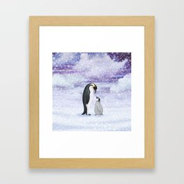 emperor penguins in the snow Framed Art Print