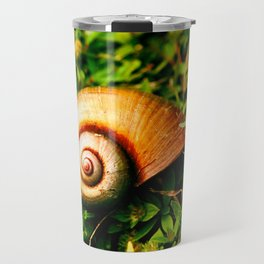 small shell between the leafs Travel Mug