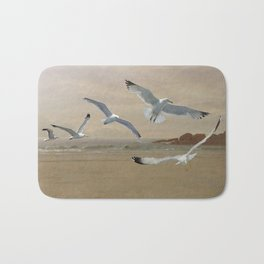 Seagulls Flying Along the Beachfront Bath Mat