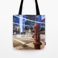 the lights Tote Bags featuring Lights by Justin Forster Photo