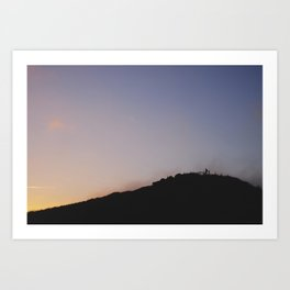 Male silhouetted on mountain top at sunset. Derbyshire, UK Art Print