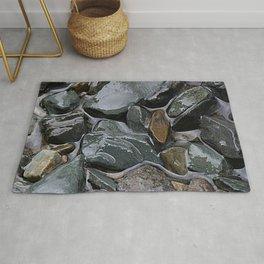 rocks in the rain Rug