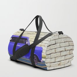 blue classic car on the road with brick wall background Duffle Bag