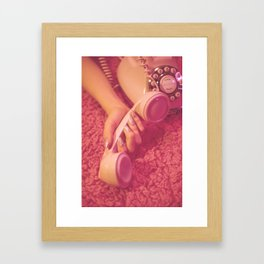 Hand with phone on pink carpet Framed Art Print