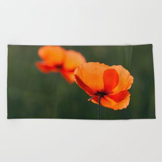Poppies secretly in love Beach Towel