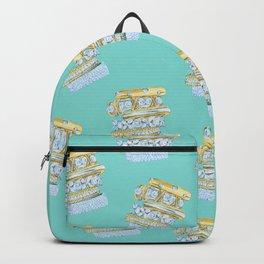 Golden Rings on Blue Backpack