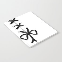 Laced Black Ribbon on White Notebook