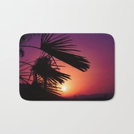 Andalusian sunset with silhouette palm trees and mountain Bath Mat