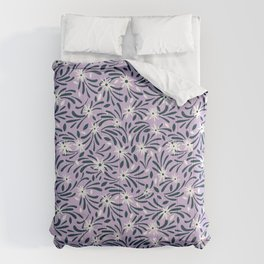 White flowers over a purple background Comforters