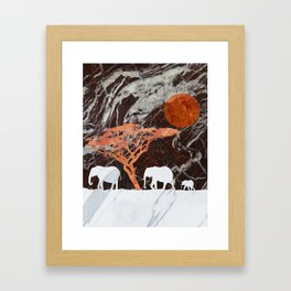 Elephants in the sun Framed Art Print