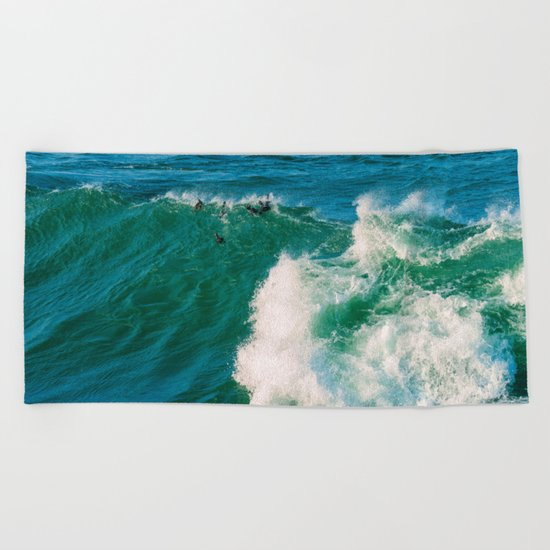 Ducks riding a wave Beach Towel