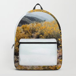 vintage style yellow poppy flower field with summer sunlight Backpack