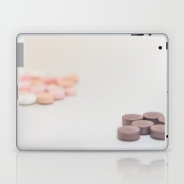 Numerous medicines Medications in the form of tablets. Colored pills on a white background. Laptop & iPad Skin