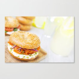 Bagel with salmon and cream cheese, brightly lit Canvas Print