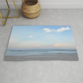 sand surf and clouds in the sky Rug