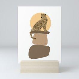 Leopard on the rocks Mini Art Print
