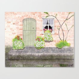 Green door by the canal Canvas Print