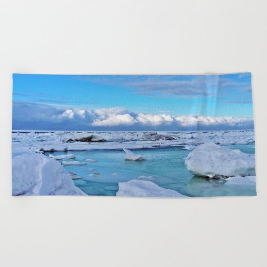 Frozen, and clouds on the Horizon Beach Towel