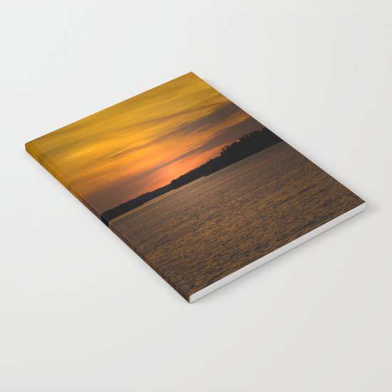 The sun goes down and night falls Notebook