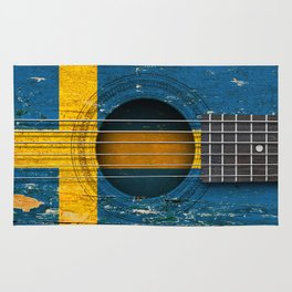 Old Vintage Acoustic Guitar with Swedish Flag Rug