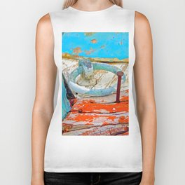 A boat that was washed ashore on Ageon Sea, decaying in the sun. Biker Tank
