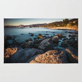 Photograph of a rocky coastline and beach Rug
